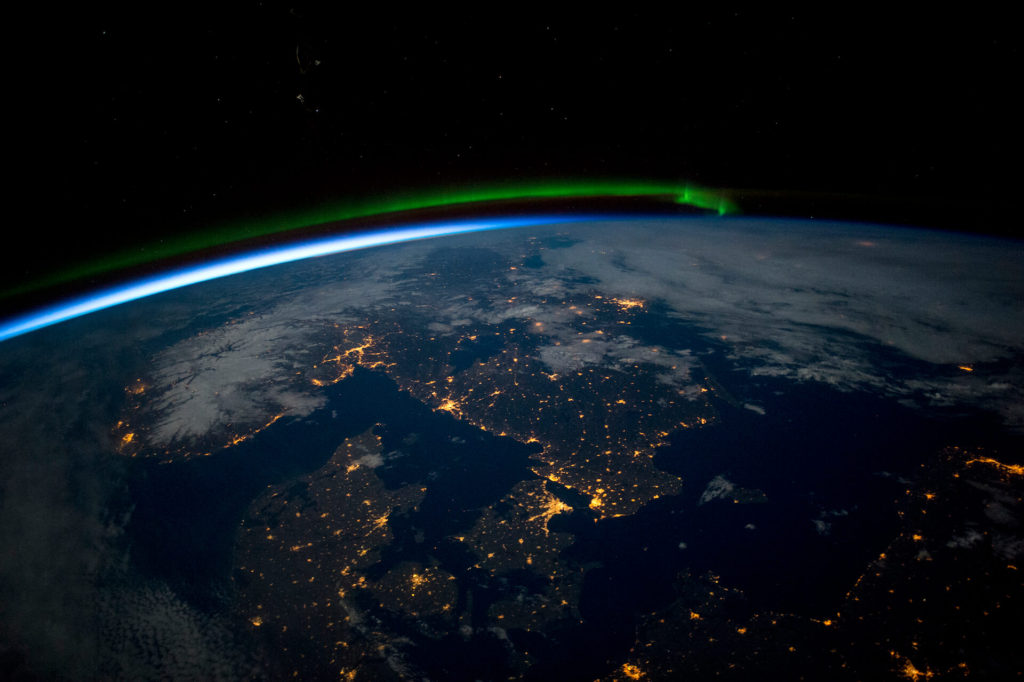 Scandinavia at Night From Space With Green Aurora